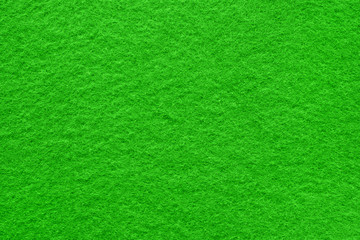 Green felt table surface extremal close up. Large macro texture