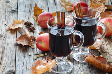 Hot red wine with spices in glass