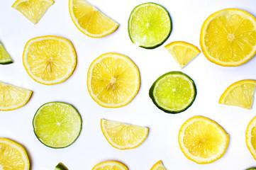 Lemon and lime slices on white