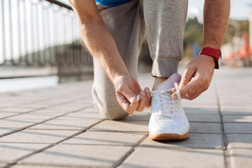 Close up of male hands tying shoelaces