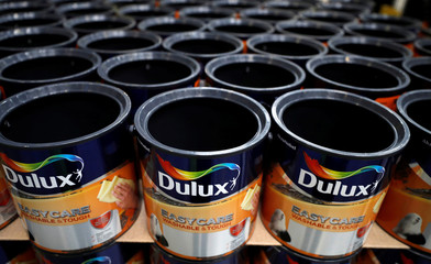 Empty Dulux paint cans wait to be filled inside AkzoNobel's new paint factory in Ashington, Britain