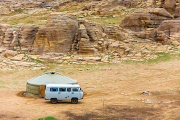 Tourist Van Outside Yurt Rocky Mongolian Landscape