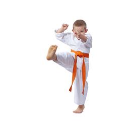The athlete beats a kick leg forward