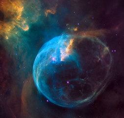 enormous bubble being blown into space by a super-hot, massive star. Hubble image of the Bubble Nebula. Elements of this image furnished by NASA.