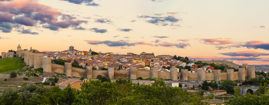 Walls of Medieval city of Avila at sunset, Spain