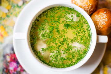 Homemade Chicken Bouillon or Broth with Bread, Horizontal Top View