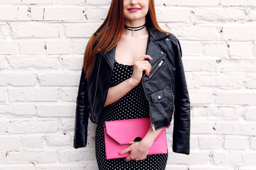 Wall Mural - Fashion happy woman wear jacket with pink bag. Hipster outfit