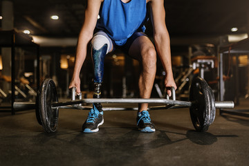 Disabled young man training in the gym.
