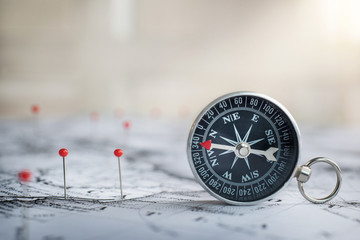 Wall Mural - Retro compass on ancient map background. Travel geography navigation concept background.