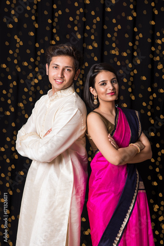 stock photo of cheerful young indian couple in traditional wear in ...