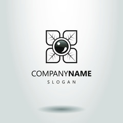 black and white simple pearl logo in the foliage
