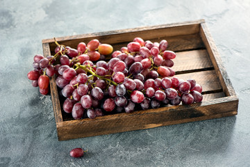 Grapes in wooden box, autumn organic harvest, healthy eating, fresh vegan vitamins