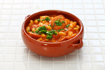 Braised with chorizo and white kidney beans, spanish tapas food,guiso de alubias blancas con chorizo