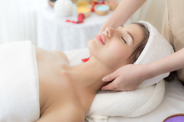 beautiful and healthy young woman relaxing with massage  at beauty spa salon
