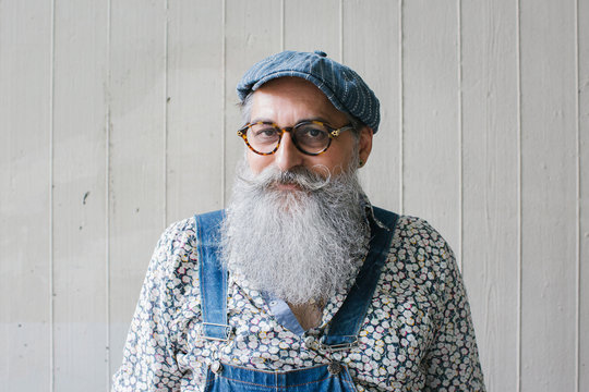 Portrait of stylish senior man with long grey beard