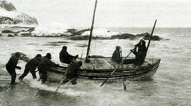 """Shackleton's Trans-Antarctic Expedition - launching the """"James Caird"""" from the shore of Elephant Island, 24 April 1916"""
