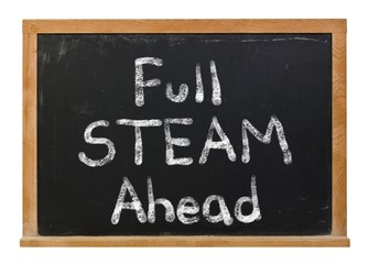 Full STEAM ahead written in white chalk on a black chalkboard isolated on white