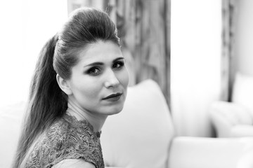 Portrait of a young woman against blurred background. Black and white image. Copyspace.