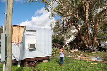 Sandra Guzman is pictured in front of her mobile home which was destroyed after the passing of Hurricane Irma in Immokalee, Florida