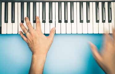 Fast hand Music keyboard player is playing on keyboard top view