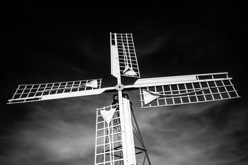 Danish stationary white old windmill