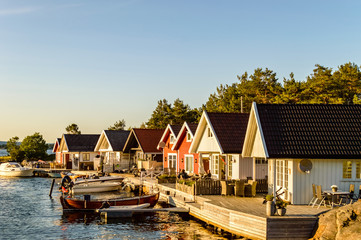 Houses along the small harbor in Norway. Sunset mood
