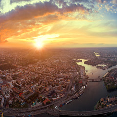 A big panorama of the city of Kiev on Podol at sunset.