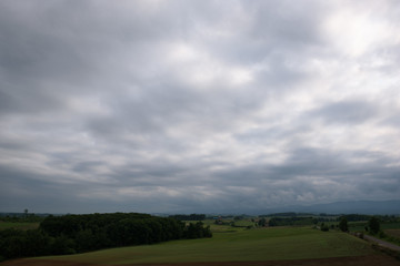Beautiful rural landscape around Biei under a cloudy sky, Biei, Hokkaido, Japan