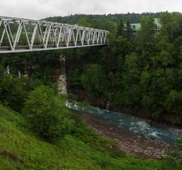 White steel bridge crossing a river, Biei, Hokkaido, Japan