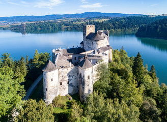 Poland. Medieval Castle in Niedzica,14th century (upper castle), Polish or Hungarian in the Past. Artificial Czorsztyn Lake and far view of the ruins of Czorsztyn castle. Aerial view in the morning Wall mural
