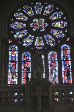 Saint-Laurent-sur-Sevre, France - September 10, 2019: Stained glass St. Louis de Montfort in Saint-Laurent-sur-Sevre
