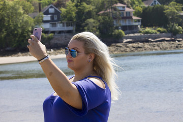Plus Size Woman Taking a Selfie on the Beach