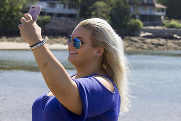 Woman Taking a Selfie on the Beach