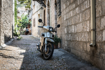 Motorbike at narrow street of Rhodes town on Rhodes island, Greece