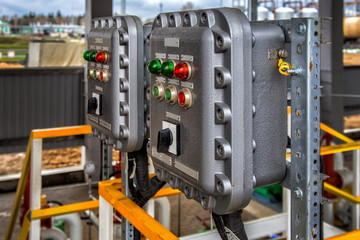 Part of power plant control panel with switches and lamps