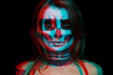 close up portrait of woman with Halloween skull make up over black background. the color shift effect is red.
