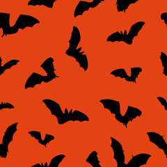 Halloween orange background with bats silhouettes festive seamless pattern. Endless background.