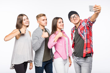 Group of happy young teenager students taking selfie photo isolated on white