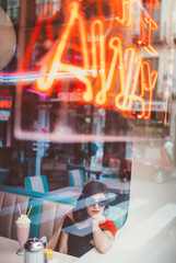 woman chilling in a diner