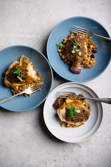 Moroccan spiced chicken thighs with couscous.