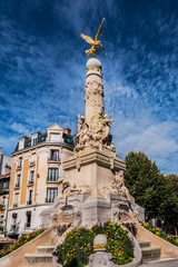 Ancient monumental fountain Sube with golden angel at top was erected in middle of Place d'Erlon, four statues represent Region Rivers: Marne, Vesle, Suippe and Aisne. Reims, Champagne-ardenne, France