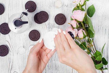 Female hand cream cotton pad cookie flowers