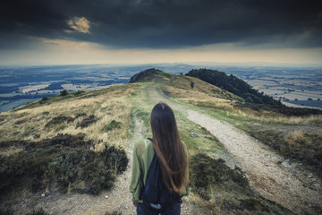 Young Girl Exploring Hilly Landscape of Wales