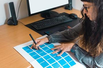 Female designer choosing color scheme
