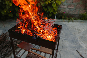 Burning dry branches in the brazier.