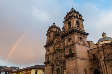 A rainbow over the Church of the Society of Jesus in Plaza de Armas in Cusco, Peru