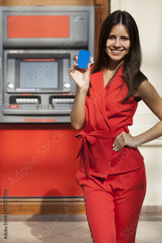 6a134a4b0401 Happy woman withdrawing money from credit card at ATM