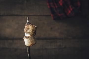 Toasted marshmallows on a stick