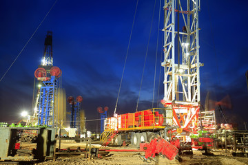 In the evening of oilfield derrick