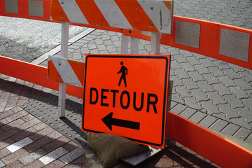 detour sign on the pedestrian sidewalk